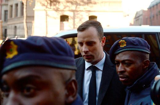 Oscar Pistorius arrives at the High Court in Pretoria, South Africa. Photo: AP Photo/Herman Verwey