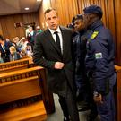 Olympic and Paralympic track star Oscar Pistorius arrives for sentencing at the North Gauteng High Court in Pretoria, South Africa. Photo: REUTERS/Marco Longari/Pool