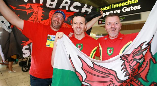 Welsh football supporters, Moz Morris, Chapolizod with Philip Roberts, Inchicore and Nathan Jones, Dundrum pictured in Dublin airport before they flew to France for the Euro 2016 semi final game against Portugal tonight. Photo: Frank Mc Grath