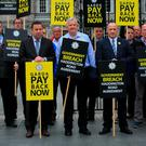 Garda Representative Association members, including deputy president Jim Mulligan, acting secretary Donal Flannery, and GRA president Ciaran O'Neill, protest about garda salaries at Leinster House last month. Photo: Gareth Chaney, Collins