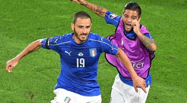 Italy's defender Leonardo Bonucci (L) celebrates with Italy's forward Lorenzo Insigne after scoring during the Euro 2016 quarter-final football match between Germany and Italy at the Matmut Atlantique stadium in Bordeaux on July 2, 2016. / AFP / Mehdi FEDOUACH (Photo credit should read MEHDI FEDOUACH/AFP/Getty Images)