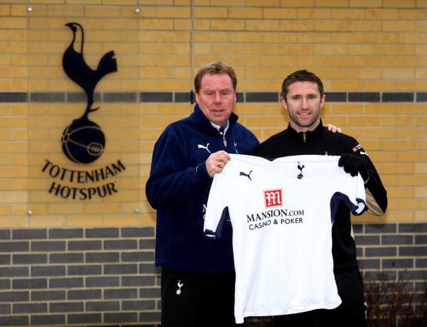 CHIGWELL, UNITED KINGDOM - FEBRUARY 06: Spurs manager Harry Redknapp poses with new signing Robbie Keane at a Tottenham Hotspur training session at Spurs Lodge on February 6, 2009 in Chigwell, England. (Photo by Richard Heathcote/Getty Images)