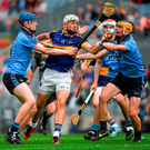 Tipperary's Thomas Nolan battles with Dublin pair Eoin Foley, left, and Cian Hendricken