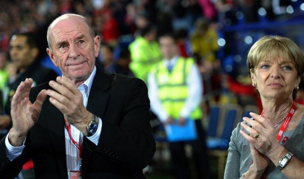 Roger and Carol Speed, parents of Gary Speed. applaud before the Gary Speed Memorial Match, a friendly international football match between Wales and Costa Rica at The Cardiff City Stadium in Cardiff, south Wales on February 29, 2012. The game was played in memory of former Welsh manager and captain who took his own life in 2011. AFP PHOTO/PAUL ELLIS (Photo credit should read PAUL ELLIS/AFP/Getty Images)