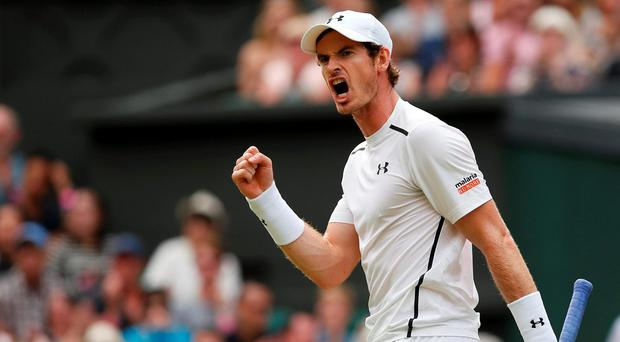 Andy Murray celebrates winning the first set in his match against France's Jo-Wilfried Tsonga