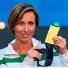 Olive Loughnane of Ireland with her gold medal for the Women's 20km Walk