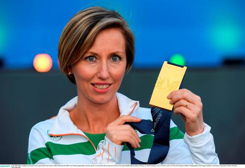Olive Loughnane of Ireland with her gold medal for the Women's 20km Walk, from the 2009 IAAF World Championships in Berlin, that she was presented with retrospectively after previous gold medallist Olga Kaniskina of Russia was banned