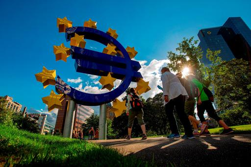 Pedestrians walk past the former European Central Bank HQ in Frankfurt Photo: Krisztian Bocsi/Bloomberg