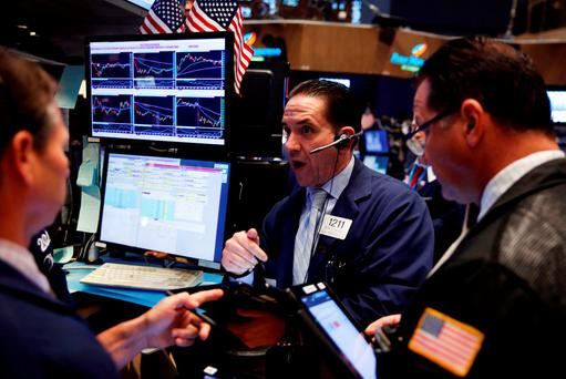 Traders work on the floor of the New York Stock Exchange (NYSE) shortly after the opening bell. Photo: Reuters
