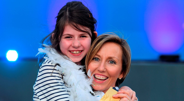 Olive Loughnane celebrates her upgraded gold medal with her daughter Eimear last night after previous winner of the 2009 World Championships 20km walk Olga Kaniskina was banned. Photo by Brendan Moran/Sportsfile