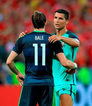 Wales' Gareth Bale (left) and Portugal's Cristiano Ronaldo embrace