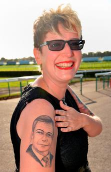 UKIP supporter Kerrie Webb, who became known as Nigel Farage's biggest fan when she had a picture of the UKIP leader tattooed on her arm Photo: Anna Gowthorpe/PA Wire