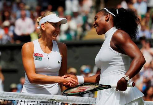 USA's Serena Williams shakes hands with Russia's Elena Vesnina after winning their semi-final REUTERS/Justin Tallis/Pool