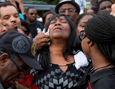 Sandra Sterling, reacts during community vigil in memory of her nephew, Alton Sterling, who was shot dead by police, at the Triple S Food Mart in Baton Rouge, Louisiana. Reuters/Jeffrey Dubinsky