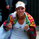 Angelique Kerber celebrates following her win over Venus Williams. Anthony Devlin/PA Wire