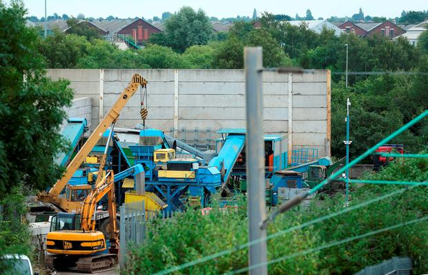 The scene at Hawkeswood Metal Recycling in the Nechells area of Birmingham where five men died after a wall collapsed. Chris Radburn/PA Wire