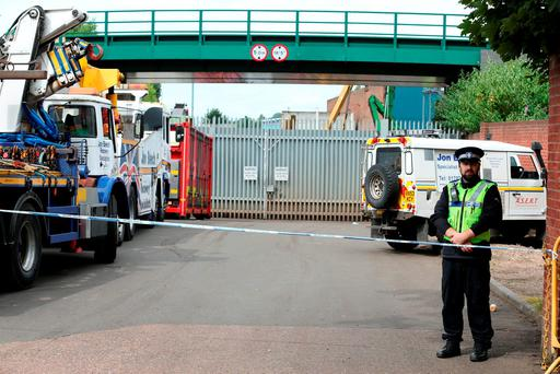 Police at the scene at Hawkeswood Metal Recycling in the Nechells area of Birmingham where five men died after a wall collapsed. Chris Radburn/PA Wire