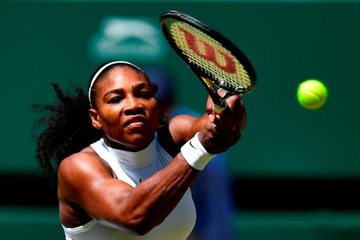 Serena Williams reaches for a return as she makes short work of Elena Vesnina Picture Credit: Leon Neal/AFP/Getty Images