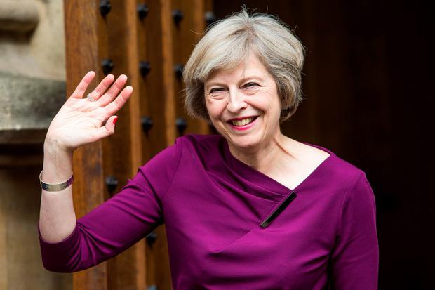 Theresa May waves to supporters outside parliament after topping the poll Photo: Jack Taylor/Getty Images