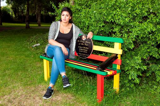 Alex Ryan's sister Nicole on a bench dedicated to his memory in Millstreet Town Picture: John Delea