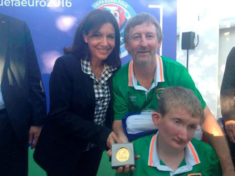 Jamie Monaghan with his dad Philip and the mayor of Paris, Anne Hidalgo, after the award was presented in the French capital last night