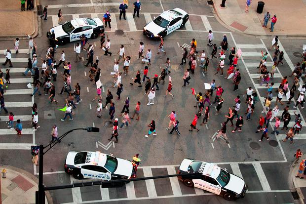 Protesters march during a Black Live Matter rally in downtown Dallas