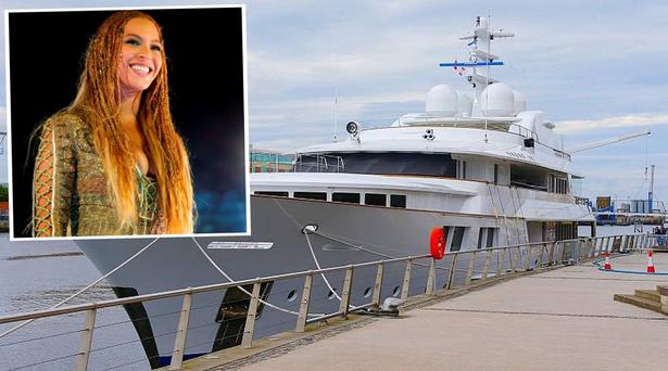 A yacht docked outside the SSE arena in Belfast, and Beyonce, inset. Picture: Kevin Scott/Belfast Telegraph