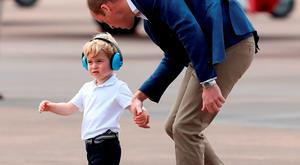 Prince William, Duke of Cambridge and Prince George during a visit to the Royal International Air Tattoo at RAF Fairford on July 8, 2016 in Fairford, England. (Photo by Chris Jackson/Getty Images)
