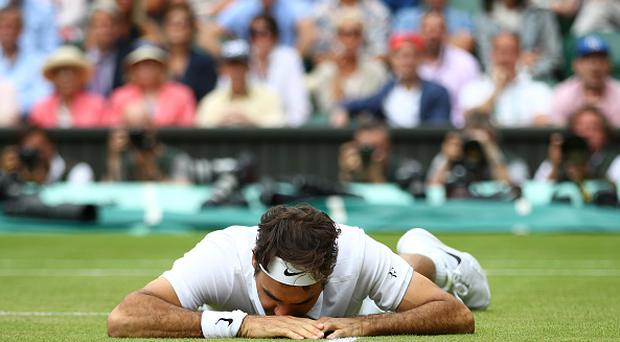LONDON, ENGLAND - JULY 08: Roger Federer of Switzerland reacts after he slips during the Men's Singles Semi Final match against Milos Raonic of Canada on day eleven of the Wimbledon Lawn Tennis Championships at the All England Lawn Tennis and Croquet Club on July 8, 2016 in London, England. (Photo by Clive Brunskill/Getty Images)