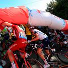 Alberto Contador, Jurgen Van den Broeck and Stef Clement try to pass under the deflated arch of the last kilometer of the 162,5 km. Photo: Getty Images