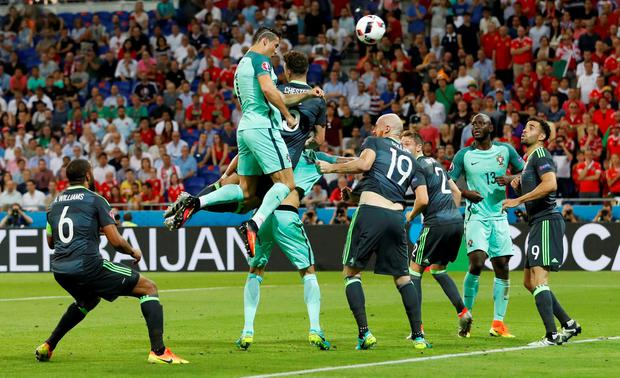 Cristiano Ronaldo scores Portugal's first goal vs Wales on Wednesday's match. Photo: Carl Recine