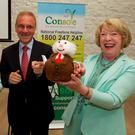 Former Console chief Paul Kelly is seen here with Ireland's first lady Sabina Higgins with a tea cosy in the image of the President Michael D Higgins in Mayo in 2015 to help launch the Cosy Up To Console national suicide awareness campaign. Mr Kelly is now at the centre of a growing scandal over allegations concerning his governance of the charity Photo: Keith Heneghan