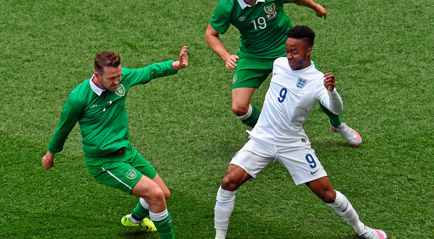 Raheem Sterling, England, in action against Aiden McGeady, left, and Robbie Brady, Republic of Ireland. Photo: Sportsfile