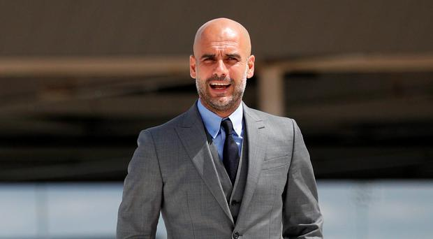 Pep Guardiola cuts a dapper figure in Manchester yesterday. Photo: Phil Noble
