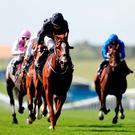 Alice Springs, with Ryan Moore up, on the way to winning the Falmouth Stakes at Newmarket. Photo: Simon Cooper