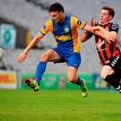 Bray's Gareth McDonagh battles it out with Ayman Ben Mohamed at Dalymount Park. Photo: Sportsfile