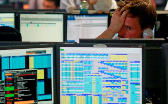 Traders from BGC, a global brokerage company in London's Canary Wharf financial centre react as European stock markets open early. Photo: Reuters