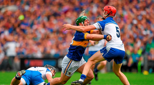 Tipperary's Kevin O'Halloran finds his path blocked by Waterford duo Tadhg de Búrca and Noel Connors, in last year's Munster SHC final Picture credit: Ray McManus / SPORTSFILE