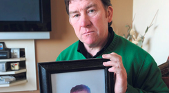 Peter Roche with a picture of his son Colin Photo: Ray Ryan