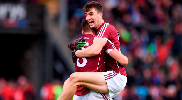 Galway's Paul Conroy, left, and Enda Tierney celebrate following their side's victory over Mayo in the Connacht SFC semi-final Photo by Ramsey Cardy/Sportsfile