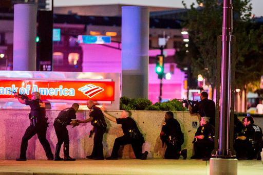 Armed police officers respond after shots were fired at a Black Lives Matter rally in Dallas, killing five officers Picture: Smiley N. Pool/The Dallas Morning News