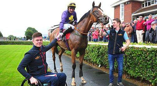Robbie McNamara greets Conor Brassil and Chadic after their victory in the Mallow Maiden Hurdle. Twitter credit: @BoyleSports
