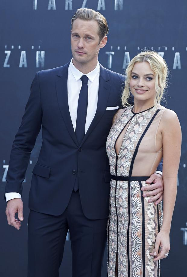 Swedish actor Alexander Skarsgard and Australian actress Margot Robbie pose for photographers as they arrive to attend the European premiere of the film The Legend of Tarzan in central London on July 5, 2016. / AFP / Niklas HALLE'N / Getty Images