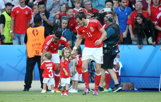 PARIS, FRANCE - JUNE 25: Gareth Bale of Wales celebrates the victory with his daughter Alba Bale following the UEFA EURO 2016 round of 16 match between Wales and Northern Ireland at Parc des Princes on June 25, 2016 in Paris, France. (Photo by Jean Catuffe/Getty Images)