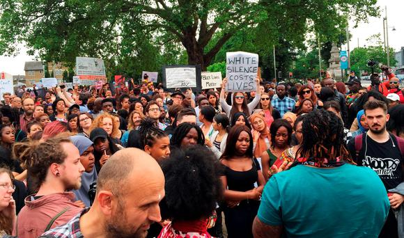 Hundreds of demonstrators protest in Windrush Square in Brixton, London, against the killing of two black men in the United States Credit: David Wilcock/PA Wire