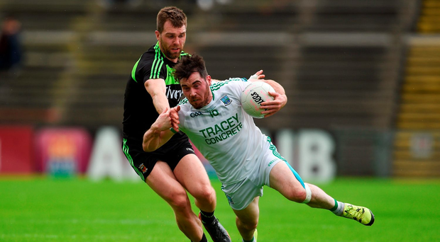 Fermanagh's Barry Mulrone is tackled by Séamus O'Shea during yesterday's game in Castlebar. Photo: Ramsey Cardy
