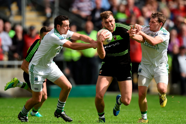 Aidan O'Shea of Mayo is tackled by Damian Kelly, left, and Declan McCusker of Fermanagh. Photo: Sportsfile