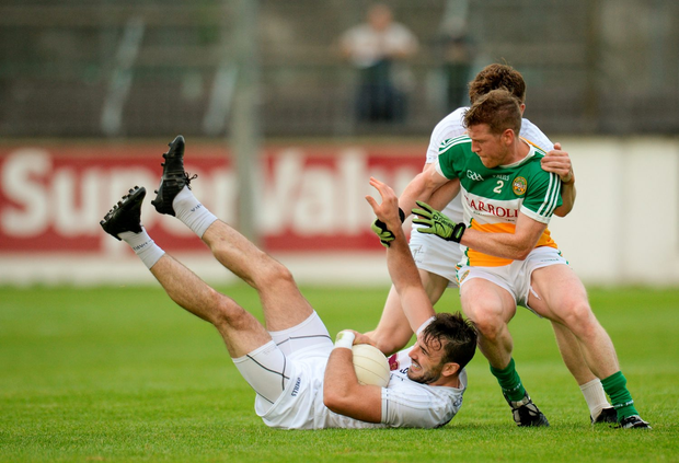 Fergal Conway of Kildare, supported by team-mate Kevin Feely, in action against Brian Darby of Offaly. Photo: Sportsfile