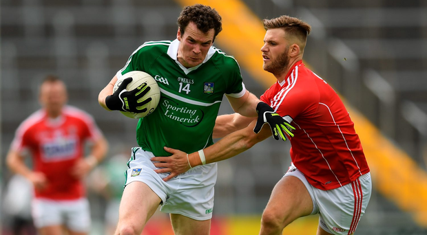 Ian Ryan of Limerick in action against Eoin Cadogan of Cork. Photo: Sportsfile