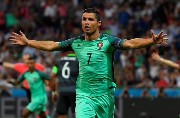 Cristiano Ronaldo of Portugal celebrates scoring the opening goal during the UEFA EURO 2016 semi final match between Portugal and Wales at Stade des Lumieres on July 6, 2016 in Lyon, France. (Photo by Stu Forster/Getty Images)